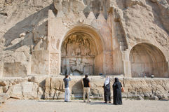Iranian tourists watching the famouse Arches of Taq-e Bostan Royalty Free Stock Photos