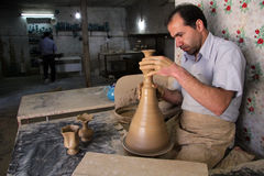 Iranian worker. LALEJIN, IRAN - CIRCA APRIL 2013 iranian worker with ceramic vase Royalty Free Stock Image