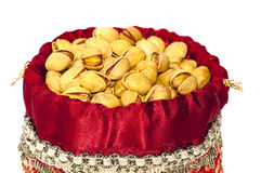 Iranian woven bag fliled with pistachio nuts. Pistachio nuts from Iran in an attractive Iranian decorated woven bag Stock Photos