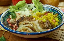 Iranian Zereshk Polo Morgh. Iranian cuisine - Zereshk Polo Morgh,Persian classic made chicken and Persian rice Stock Photos