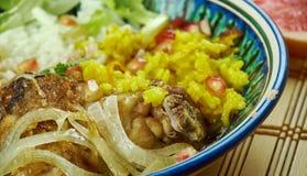 Iranian Zereshk Polo Morgh. Iranian cuisine - Zereshk Polo Morgh,Persian classic made chicken and Persian rice Stock Photo