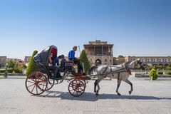 Iranians sit on carriage at Naghsh-e Jahan Square Royalty Free Stock Photos