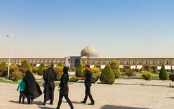 Iranians walking around the Imam Mosque, Esfahan, Iran Royalty Free Stock Images