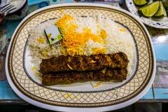 Iranier Kabab Koobideh arkivbilder