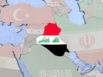 Iraq with flag on globe Royalty Free Stock Photo