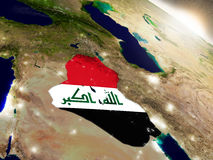 Iraq with flag in rising sun Stock Photography