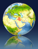 Iraq on globe with reflection. Illustration with detailed planet surface. Elements of this image furnished by NASA Royalty Free Stock Photography