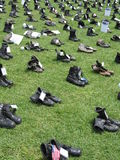 Iraq Memorial. Photo of a portion of the traveling Eyes Wide Open memorial for soldiers lost in the Iraq War.  Each pair of boots represents a soldier killed in Royalty Free Stock Photos