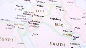 Iraq on a Political Map with Defocus. Iraq on a political map of the world. Video defocuses showing and hiding the map stock video footage
