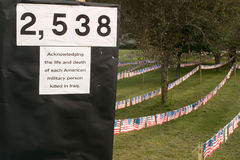 Iraq War Demonstration. This is a display in Brattleboro Vermont protesting the Iraq war. Each flag represents a US soldier killed in combat stock photo