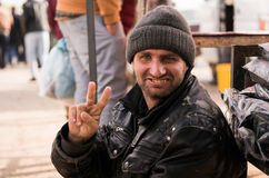 Iraqi Beggar. On the street making the victory sign Stock Photo