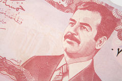 Iraqi dinars. A Ba'athist era 5 dinar Iraqi banknote, showing the image of deposed leader Saddam Hussain Royalty Free Stock Photography