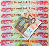 Iraqi Dinars and fifty Euro Note Royalty Free Stock Images