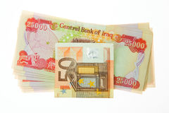 Iraqi Dinars and fifty Euro Note Stock Image