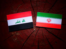 Iraqi flag with Iranian flag on a tree stump isolated Royalty Free Stock Photo