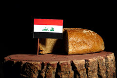 Iraqi flag on a stump with bread.  Royalty Free Stock Photography