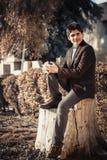 Iraqi guy sitting on cut tree Stock Images