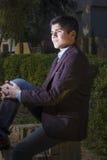 Iraqi guy sitting on cut tree Royalty Free Stock Images