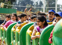 Iraqi Kids Playing. Picture for Iraqi kids riding some games in  Zawraa park in Baghdad city capital of Iraq Stock Images