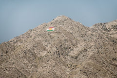 Iraqi Kurdistan. A Kurdish flag is embedded on a mountaintop overlooking the city of Duhok, Ninevah Province, Iraqi Kurdistan, June 6, 2014 Stock Image