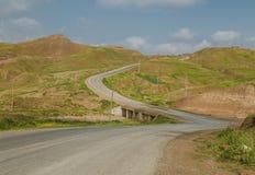 Iraqi landscape in Spring. Curved way in Iraqi Kurdistan region between Erbil and Kirkuk city Royalty Free Stock Image