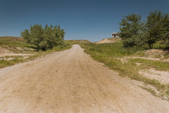 Iraqi Landscape in Summer. Unpaved road in Iraqi desert in Summer season Royalty Free Stock Images