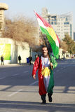 An Iraqi man carrying Kurdistan flag on new Year Stock Image