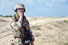 Iraqi soldier. In the desert talking portable radio station Royalty Free Stock Photo