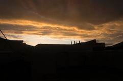 Iraqi Sunset Skyline. Iraqi Houses in sunset with electrical grid and clouds Royalty Free Stock Image