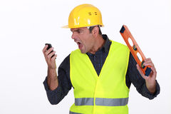 Irate builder shouting Stock Photo