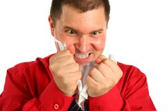 Irate man in red shirt rips sheet of paper Stock Image