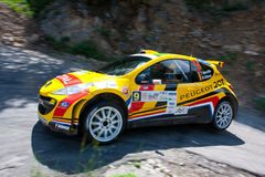 IRC PRIME Yalta Rally 2011. YALTA, UKRAINE - JUNE 4: Driver Neuville T. and co-driver Gilsoul N. drives his car Peugeot 207 S2000 during the IRC PRIME Yalta Royalty Free Stock Photo