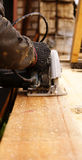 Сircular saw. Construction work on the saw cut the wood Stock Image