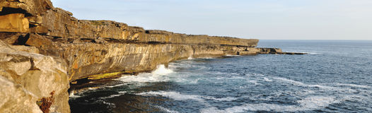 Ireland Aran island cliffs panorama. Aran Islands Inishmore, Ireland. Atlantic Ocean and cliffs panorama Stock Photos