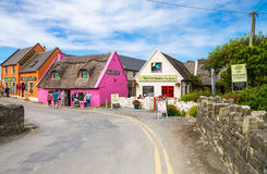 Ireland. Calway, Ireland - August 4, 2013: Tourists between the  colored houses of the Doolin village Stock Photos