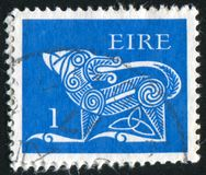 Postage stamp. IRELAND - CIRCA 1968: stamp printed by Ireland, shows Dog from Ancient, circa 1968 stock photos
