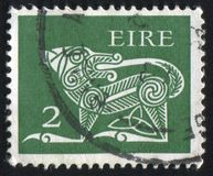 Postage stamp. IRELAND - CIRCA 1968: stamp printed by Ireland, shows Dog from Ancient, circa 1968 stock images