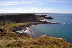 Ireland cliff. White cliff ireland in the sea relax black rocks Royalty Free Stock Photos