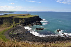Ireland cliff. White cliff ireland in the sea relax black rocks Stock Image