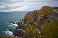 Ireland cliffs and ocean landscape. And the sea crashing against the rocks below stock photography
