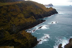 Ireland cliffs and ocean landscape. With the waves crashing against the rocks Royalty Free Stock Image