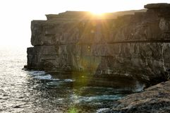 Ireland cliffs at sunset 1. Aran Islands Inishmore, Ireland. Sunset on the Atlantic Ocean from Inishmore cliff Stock Photography