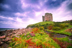 Ireland Coast and Castle Ruins. Coastal landscape along the Dingle Peninsula, County Kerry in Ireland with medieval castle ruins and dramatic sky royalty free stock photos