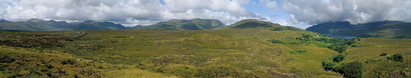 Ireland / Connemara panormic view. Lush landscape in western ireland, connemara, 12 bens country Royalty Free Stock Images