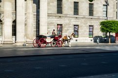 Ireland. Dublin. Echoes by past in the Irish capital. A horse-drawn carriage runs in the morning on O'Connell Street in front of the historic building of General Royalty Free Stock Photography