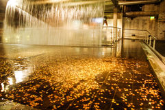 Ireland. Dublin. Guinness Storehouse. The waterfall. The water is one of four ingredients for make beer celebrated in Guinness Storehouse. In the basin of the Royalty Free Stock Photos