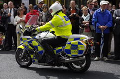 Ireland. Dublin. June 06 2012. A policeman on motorbike of the Garda. Service of order among the crowd in Nassau Street for the passage of the torch-bearers with Stock Photo