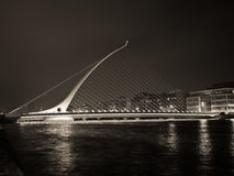 Ireland - Dublin Samuel Beckett Bridge At Night. Samuel Beckett Bridge over River Liffey in the center of Dublin is a modern masterpiece. Designed by Dr stock photo