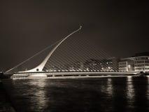 Ireland - Dublin Samuel Beckett Bridge At Night. Samuel Beckett Bridge over River Liffey in the center of Dublin is a modern masterpiece. Designed by Dr Stock Photo