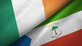 Ireland and Equatorial Guinea two flags textile cloth, fabric texture. Ireland and Equatorial Guinea two folded flags together stock illustration